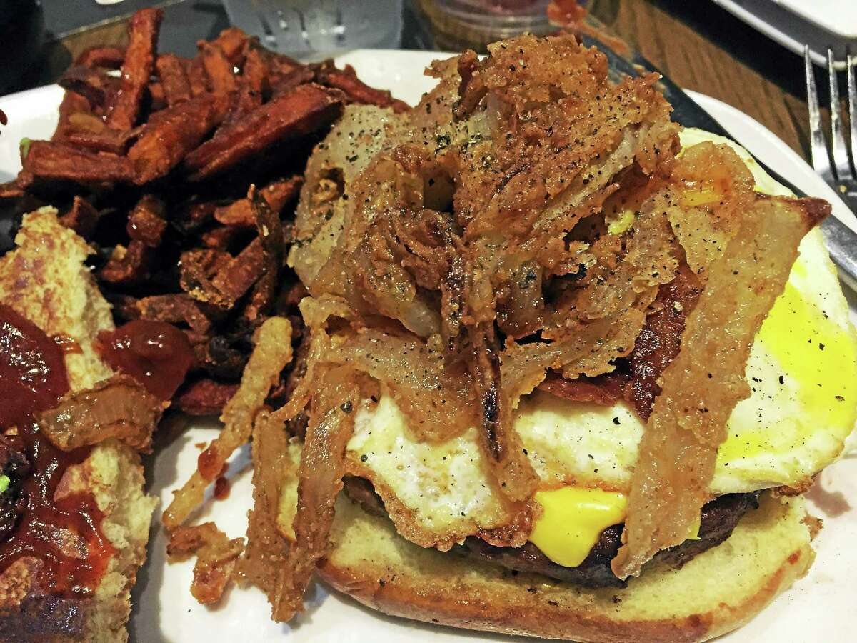 Tom's Urban's Sin City burger, with American cheese, fried egg, crispy onions, bacon and BBQ sauce.