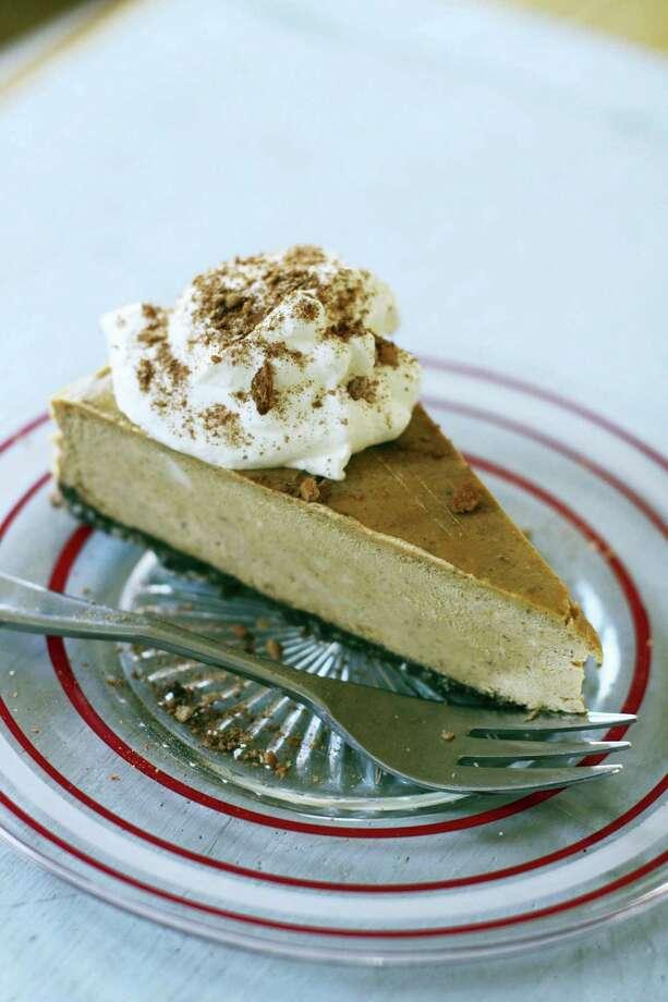 Pumpkin-bourbon cheesecake is even better served warm. Photo: Matthew Mead — The Associated Press  / FR170582 AP