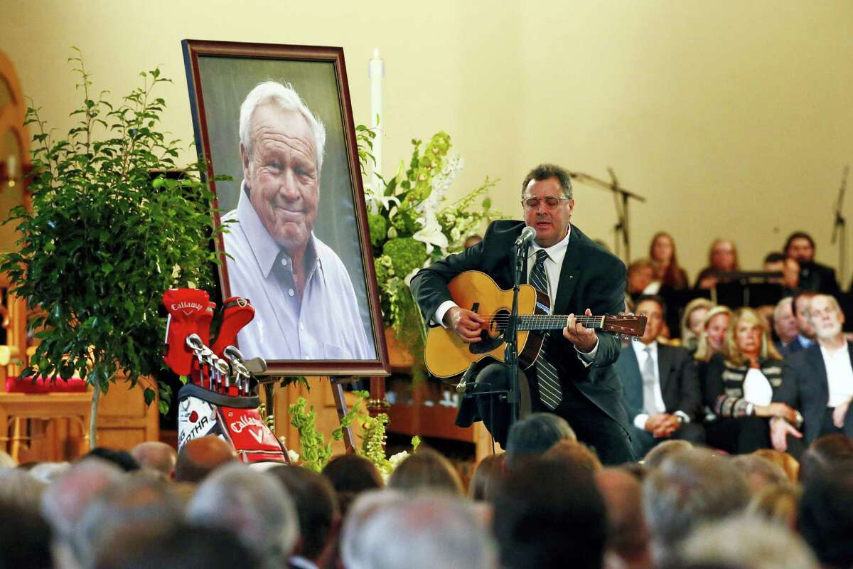 Country artist Vince Gill performs during a memorial service for golfer Arnold Palmer in the Basilica at Saint Vincent College in Latrobe, Pa., Tuesday.