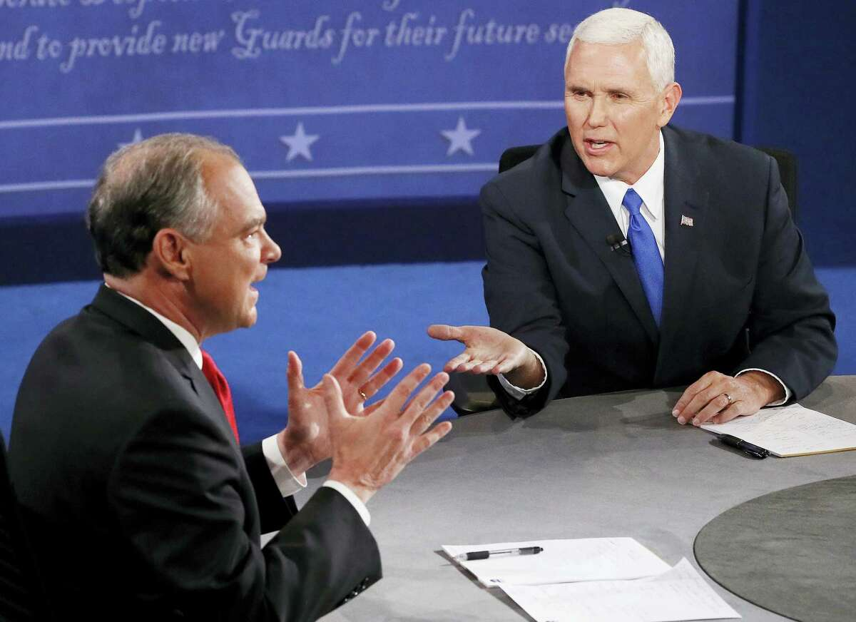 Republican vice-presidential nominee Gov. Mike Pence, right, and Democratic vice-presidential nominee Sen. Tim Kaine speak during the vice-presidential debate at Longwood University in Farmville, Va., Tuesday.