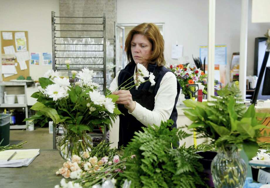 Florists often need extra help during holiday seasons and might be hiring part-time employees to fill this need. Photo: Digital First Media File Photo  / © 2014 by The York Daily Record/Sunday News