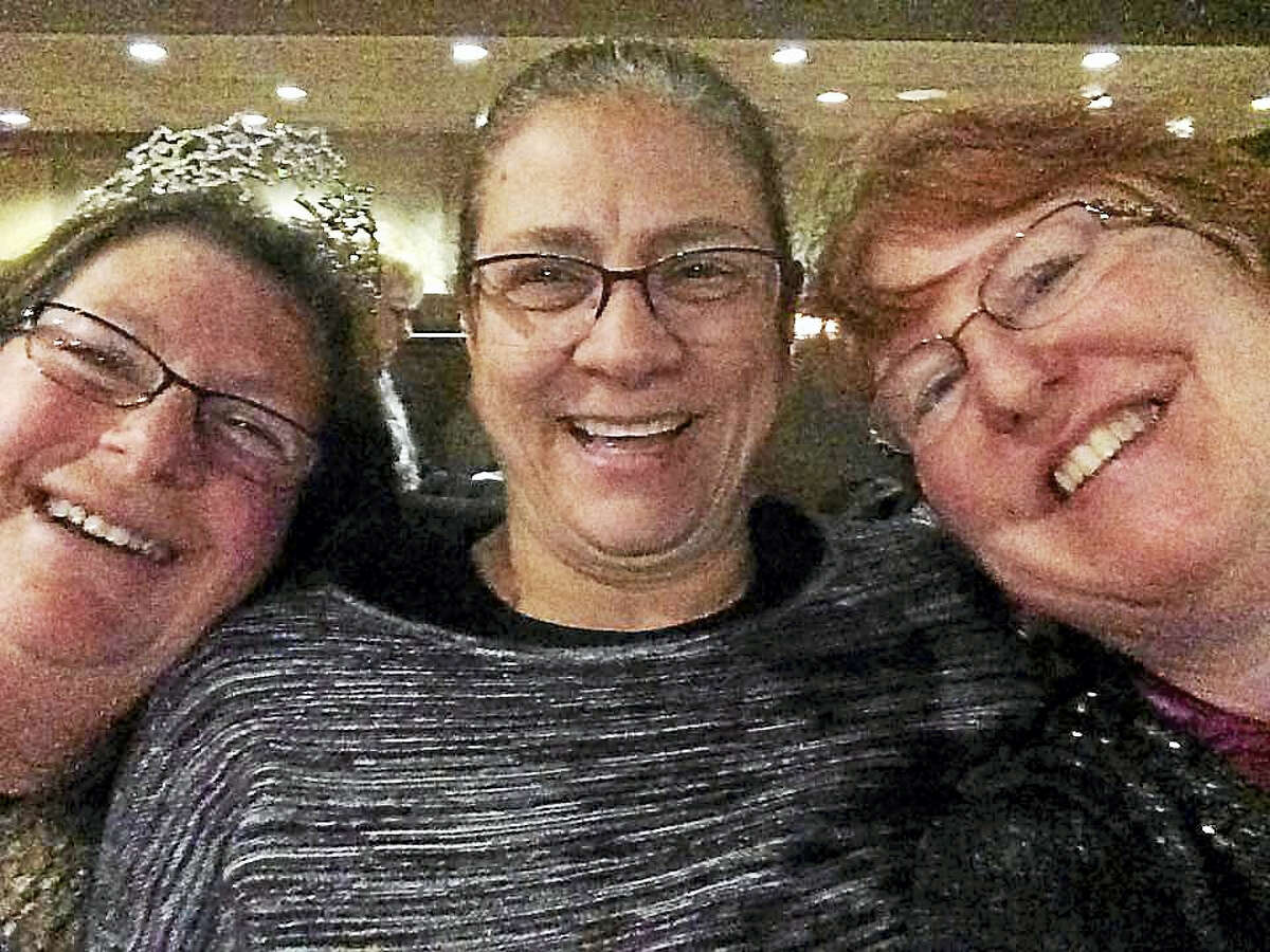 From left, best friends Sharon Hartstein, Linda Carman and Jeannette Brodeur enjoy a laugh and a selfie at the Hu Ke Lau in Chicopee, Massachusetts, for Hartstein's birthday. Carman, a Middletown resident, went missing Sept. 18 while on a fishing trip with her son Nathan Carman.