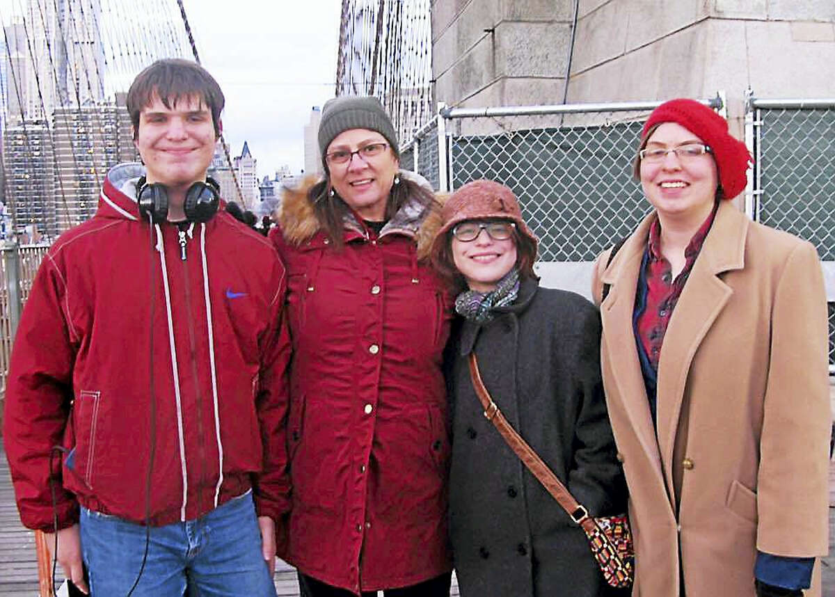 Linda Carman, second from left, poses for a photograph at the Brooklyn Bridge with Jeannette Brodeur's son and daughters last December.