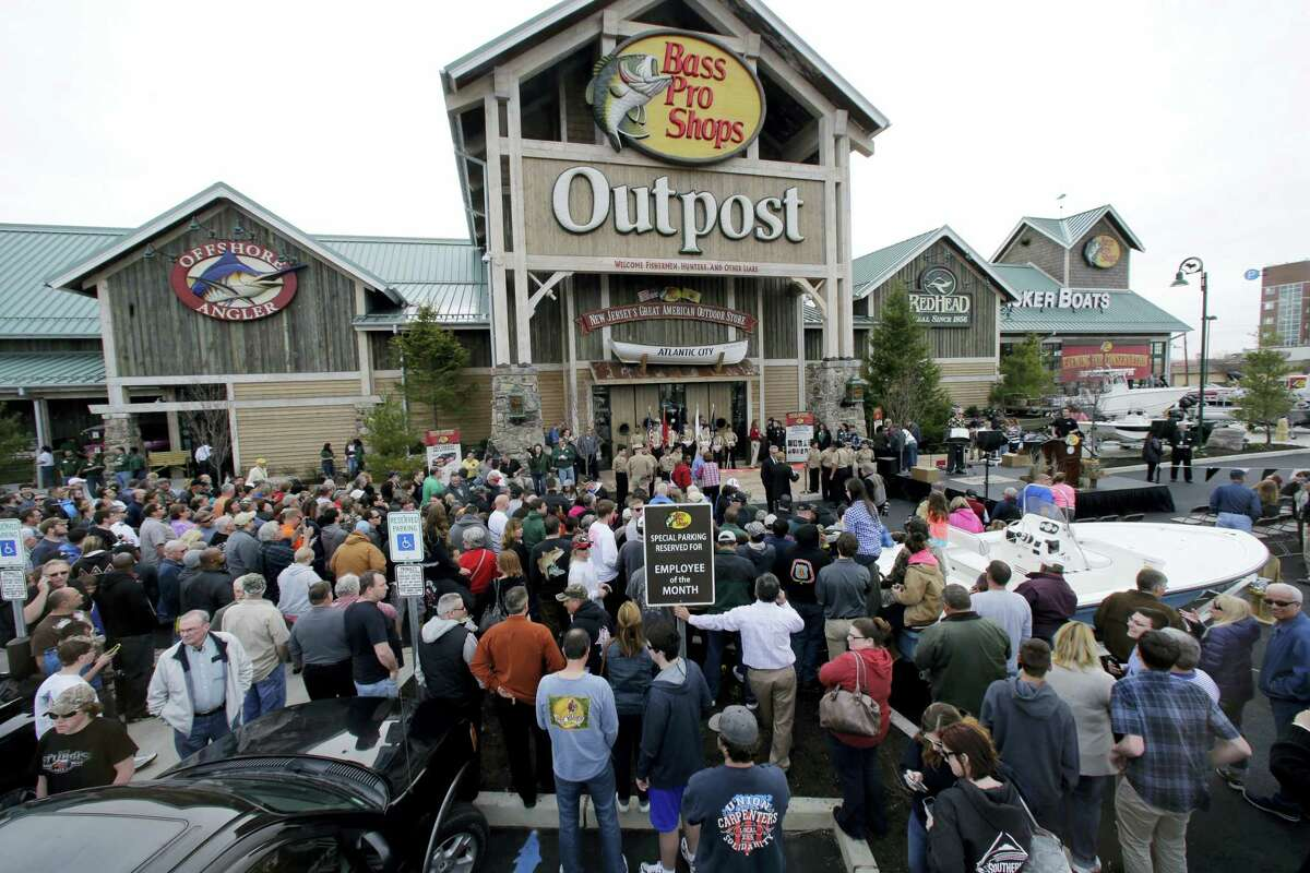 A large crowd lines up for the grand opening of Bass Pro Shops Outpost store in Atlantic City, N.J.