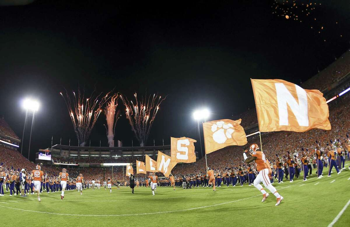 Clemson players run onto the field before Saturday's game against Louisville.