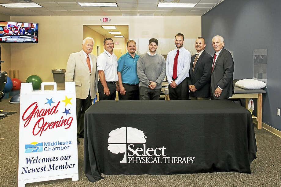 Select Physical Therapy held a grand opening on Tuesday at 140 Main St. in Metro Square, Middletown. From left are Middletown Small Business Development Director Paul Dodge, Vice President for Select Physical Therapy Mark Gombotz, Physical Therapist Ryan K. Delp, Middletown Mayor Daniel Drew, Physical Therapist Ben Simaitis, Market Manager for Select Physical Therapy William Foster and President of the Middlesex County Chamber of Commerce Larry McHugh. Photo: Sandy Aldieri, Perceptions Photography