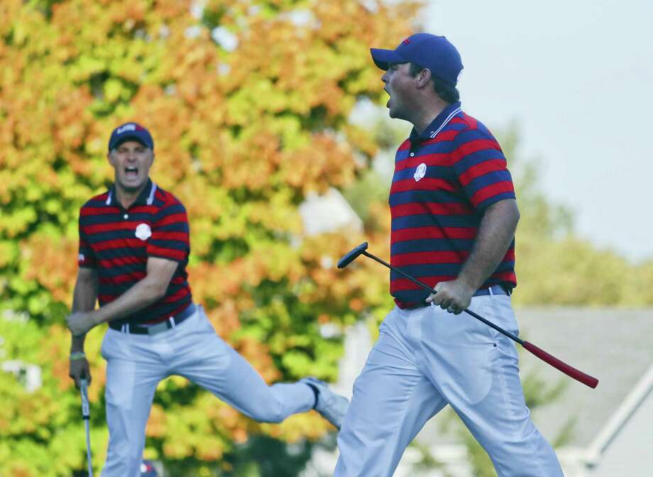 Patrick Reed, right, celebrates his birdie on the 14th hole with Jordan Spieth on Saturday. Photo: Chris Carlson — The Associated Press  / Copyright 2016 The Associated Press. All rights reserved.