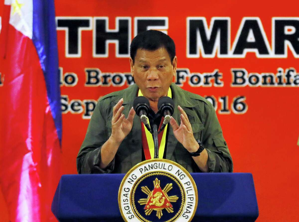 In this Sept. 27, 2016, photo, Philippine President Rodrigo Duterte addresses Philippine Marines in suburban Taguig city east of Manila, Philippines. As the body count mounts in the Philippines' war on drugs, and its combative president's rhetoric plumbs new depths, the mood in Washington toward the key Asian ally is hardening. Influential U.S. lawmakers are warning that the extra-judicial killings in the drugs war — that Duterte on Sept. 30 compared to the Holocaust — could affect American aid. (AP Photo/Bullit Marquez)