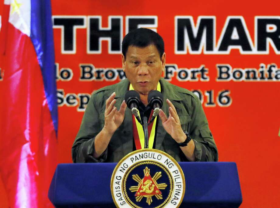 In this Sept. 27, 2016, photo, Philippine President Rodrigo Duterte addresses Philippine Marines in suburban Taguig city east of Manila, Philippines. As the body count mounts in the Philippines' war on drugs, and its combative president's rhetoric plumbs new depths, the mood in Washington toward the key Asian ally is hardening. Influential U.S. lawmakers are warning that the extra-judicial killings in the drugs war — that Duterte on Sept. 30 compared to the Holocaust — could affect American aid. (AP Photo/Bullit Marquez) Photo: AP / Copyright 2016 The Associated Press. All rights reserved.