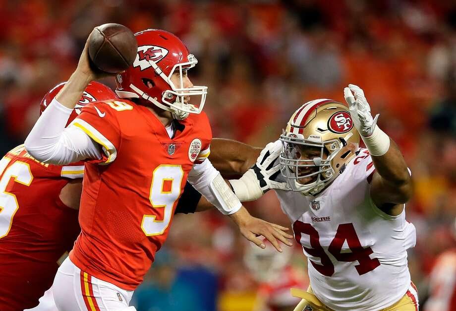 Chiefs quarterback Tyler Bray (9) passes as 49ers defensive end Solomon Thomas applies pressure. On his first snap, Thomas' pressure led to a pick. Photo: Jamie Squire, Getty Images