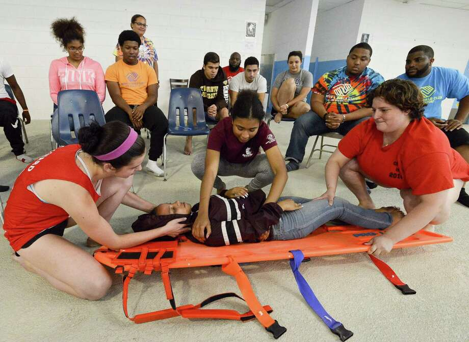 Camp counselors and life guards from the Boys and Girls Club of Stamford come together to talk about safety on the deck of the pool at the Yerwood Center on Tuesday, August 8, 2017  in Stamford, Connecticut. The safety class for staff is in response to the near-drowning that happen last week at Chelsea Piers. Photo: Matthew Brown / Hearst Connecticut Media / Stamford Advocate