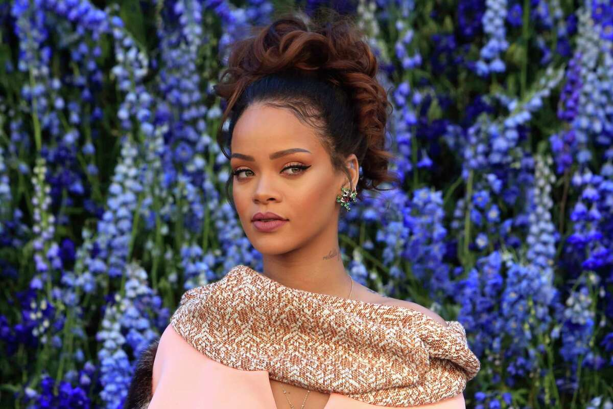 In this Oct. 2, 2015 photo, singer Rihanna poses before Christian Dior's Spring-Summer 2016 ready-to-wear fashion collection to be presented during the Paris Fashion Week, in Paris. Rihanna has released her much anticipated new album through Jay Zís Tidal streaming service, which she co-owns.