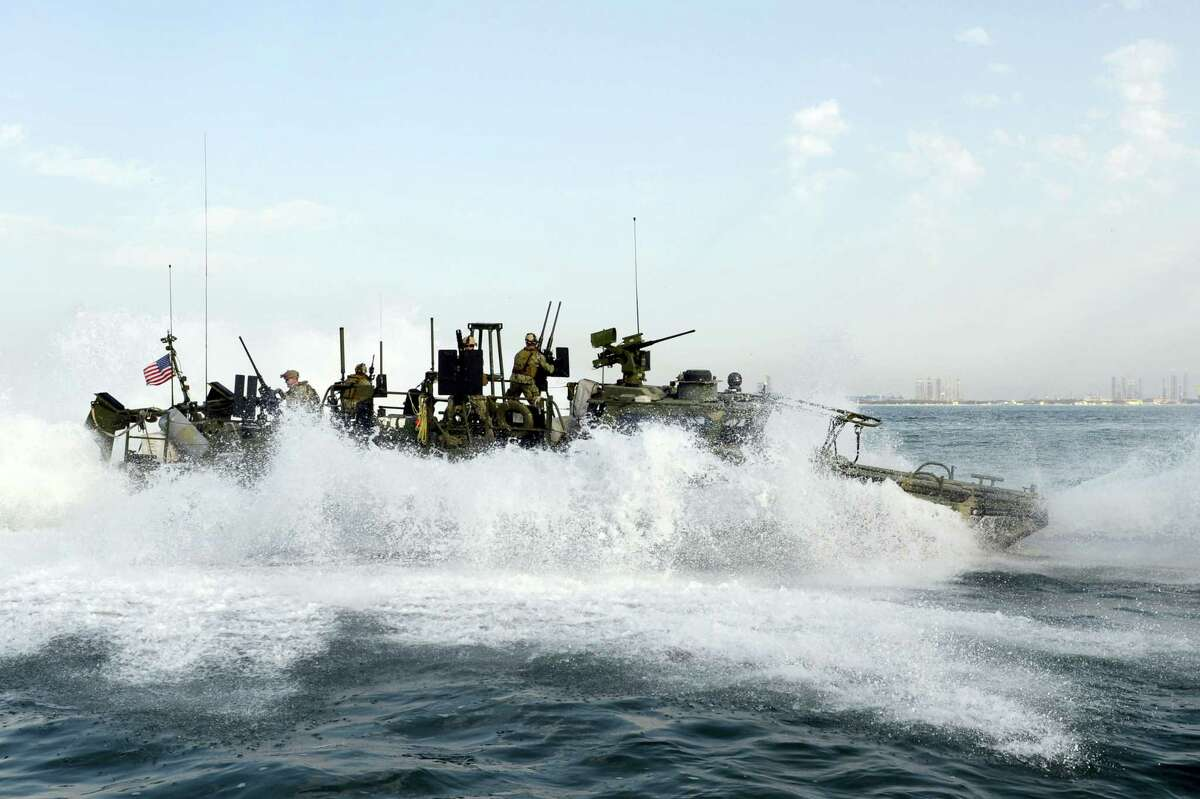 """In this Feb. 23, 2013, photo provided by the U.S. Navy, sailors assigned to Riverine Squadron (RIVRON) 2 perform an """"E"""" stop while conducting patrol operations. Iran was holding 10 U.S. Navy sailors and their two boats, similar to the one in this picture, on Jan. 12, 2016, after the boats had mechanical problems and drifted into Iranian waters. American officials have received assurances from Tehran that they will be returned safely and promptly."""