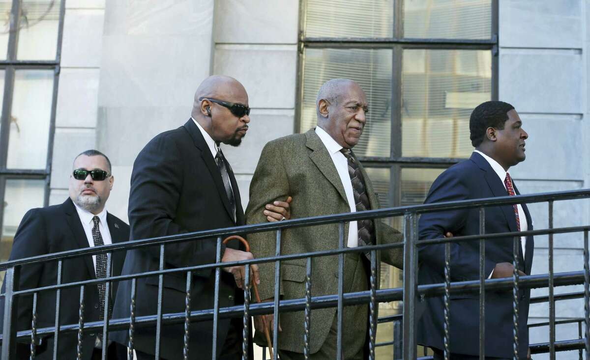 Actor and comedian Bill Cosby, second right, arrives for a court appearance Tuesday, Feb. 2, 2016, in Norristown, Pa. Cosby was arrested and charged with drugging and sexually assaulting a woman at his home in January 2004.