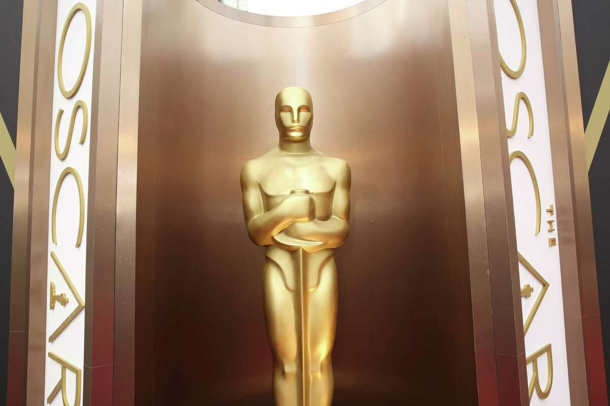 In this 2014 file photo, an Oscar statue is displayed at the Oscars at the Dolby Theatre in Los Angeles.