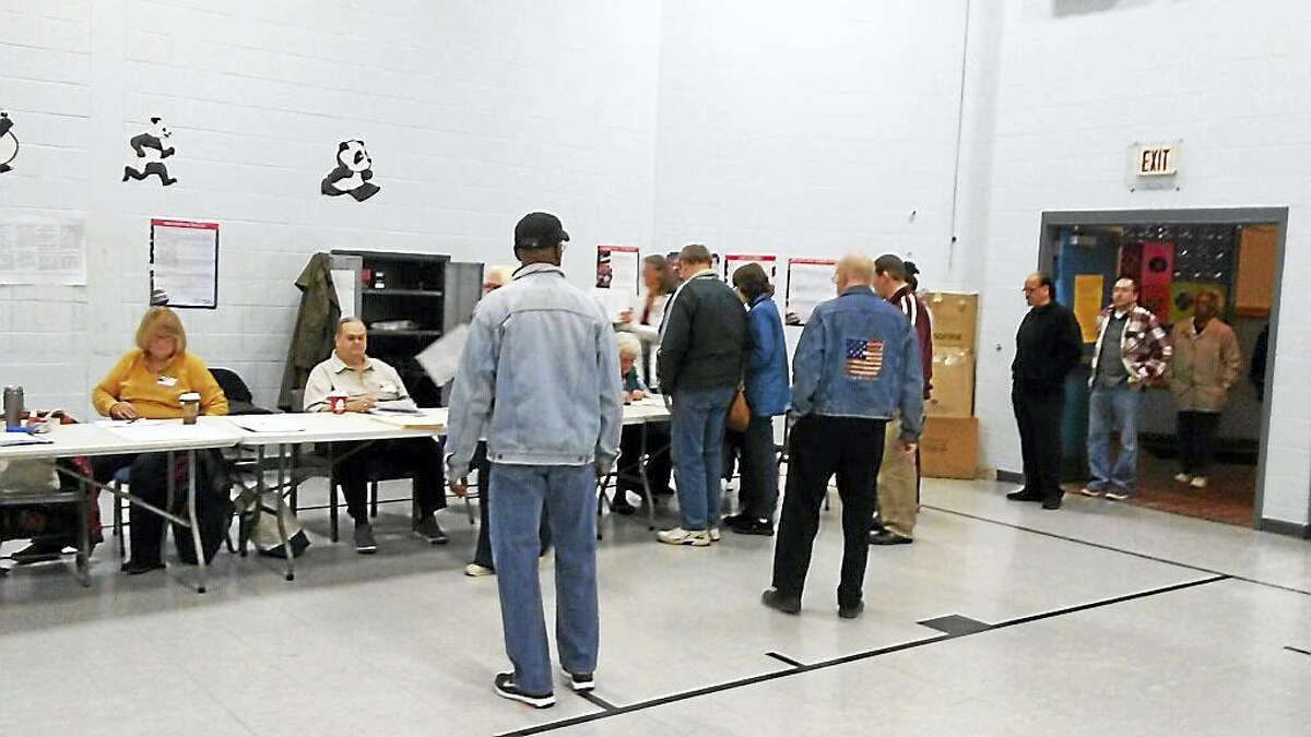 Voters queue up at Spencer School in Middletown shortly after the polls opened on Tuesday.