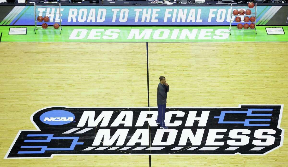 Connecticut head coach Kevin Ollie watches his team during practice for a first-round men's college basketball game in the NCAA Tournament, Wednesday, March 16, 2016, in Des Moines, Iowa. Connecticut will play Colorado on Thursday. (AP Photo/Charlie Neibergall)