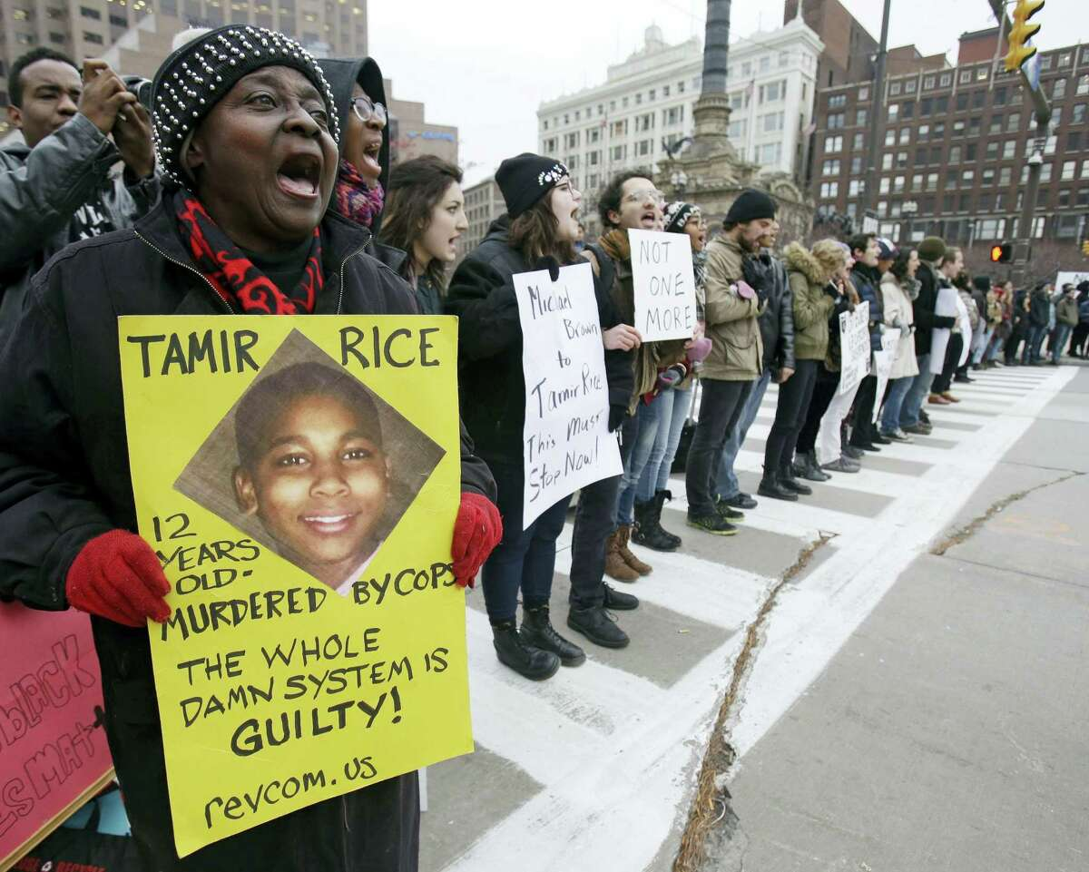 In this Nov. 25, 2014 photo, demonstrators block Public Square in Cleveland, during a protest over the police shooting of Tamir Rice. The city of Cleveland has reached a settlement April 25, 2016 in a lawsuit over the death of Rice, a black boy shot by a white police officer while playing with a pellet gun.