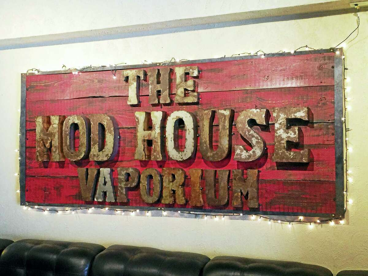 A sign on the wall at The Mod House Vaporium, 113 River St., Milford.