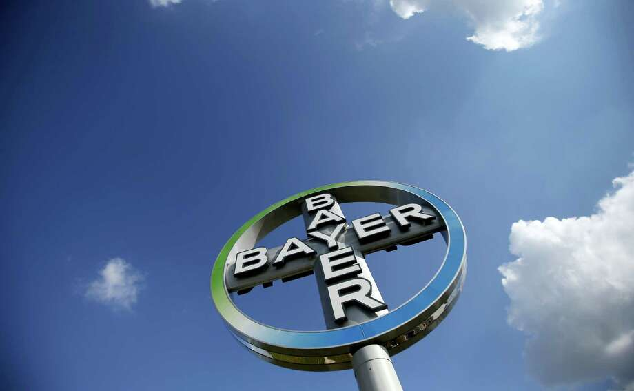 The logo of the chemical company Bayer at the Airport Berlin Brandenburg 'Willy Brandt', IATA code BER, in Schoenefeld, Germany. German drug and chemicals company Bayer AG confirmed May 19, 2016 it has entered talks with the Monsanto Company about the possible acquisition of the U.S.-based specialist in genetically modified crop seeds. Photo: AP Photo/Michael Sohn, File  / Copyright 2016 The Associated Press. All rights reserved. This material may not be published, broadcast, rewritten or redistribu