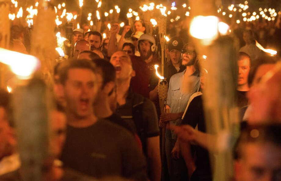 Neo Nazis, Alt-Right, and White Supremacists take part a the night before the 'Unite the Right' rally in Charlottesville, VA, white supremacists march with tiki torchs through the University of Virginia campus.  (Photo by Zach D Roberts/NurPhoto via Getty Images) Photo: NurPhoto/NurPhoto Via Getty Images