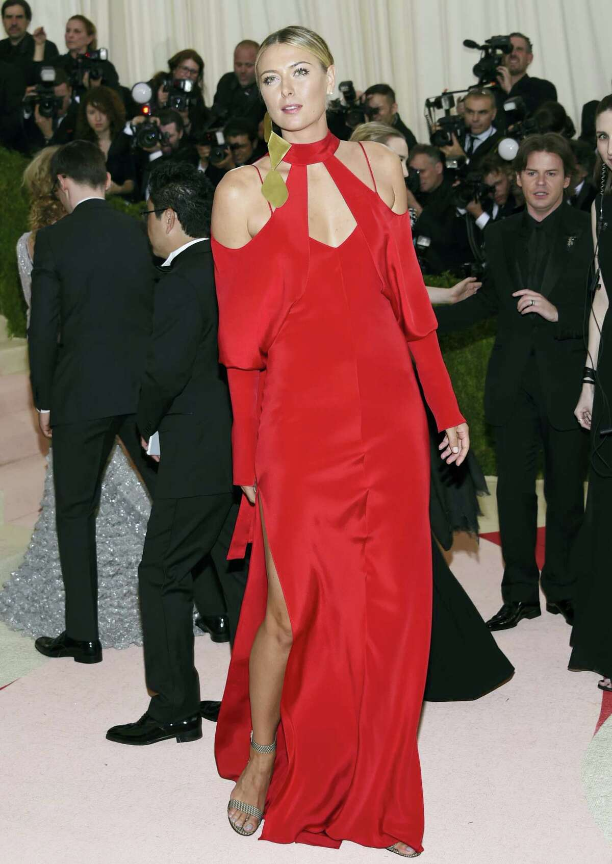"""In this Monday, May 2, 2016 photo, Maria Sharapova arrives at The Metropolitan Museum of Art Costume Institute Benefit Gala, celebrating the opening of """"Manus x Machina: Fashion in an Age of Technology"""" in New York. Sharapova has been suspended for two years by the International Tennis Federation for testing positive for meldonium at the Australian Open."""