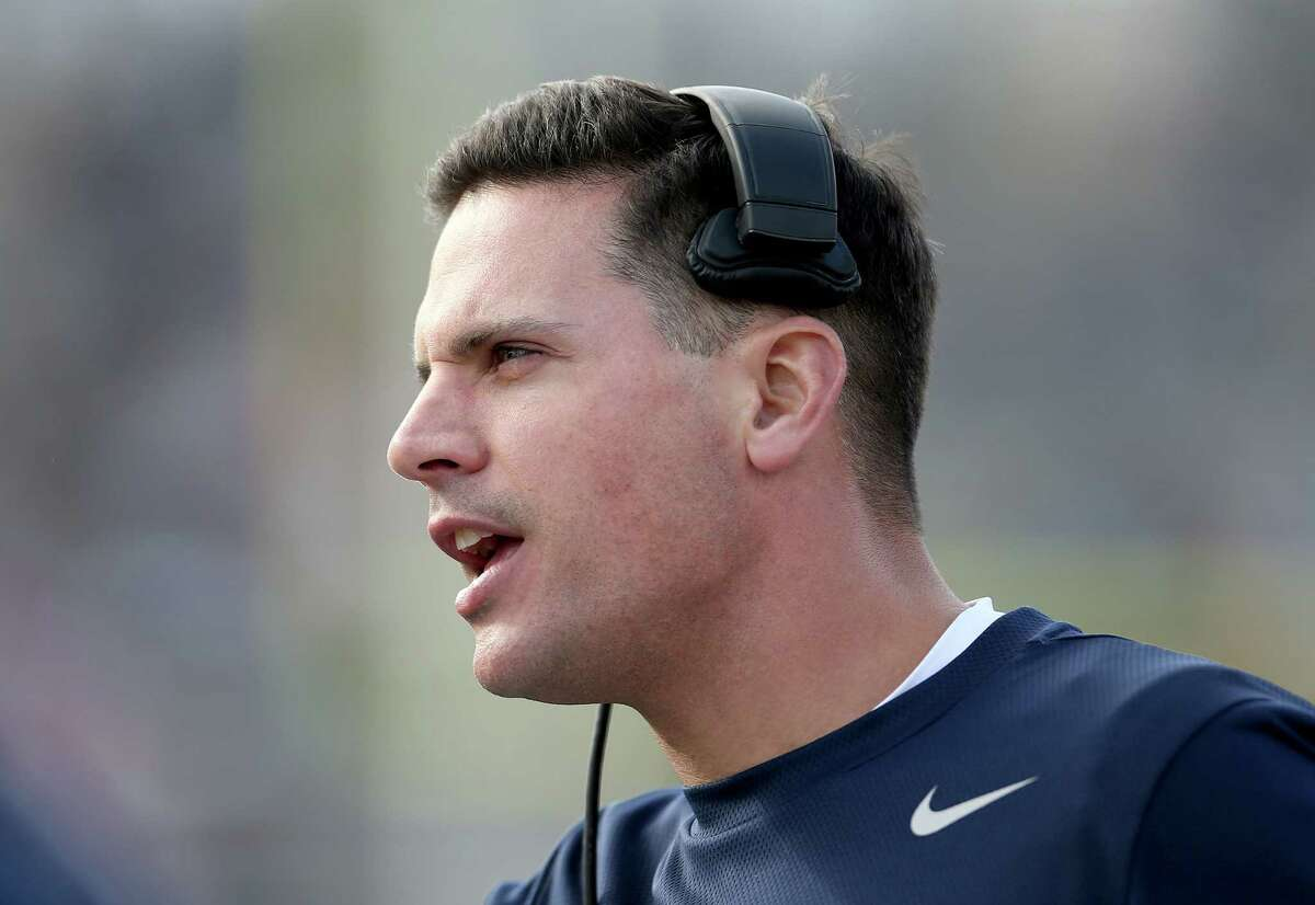 Connecticut head coach Bob Diaco yells to his team during the second half of an NCAA college football game against South Florida, Saturday, Oct. 17, 2015, in East Hartford, Conn. (AP Photo/Mary Schwalm)