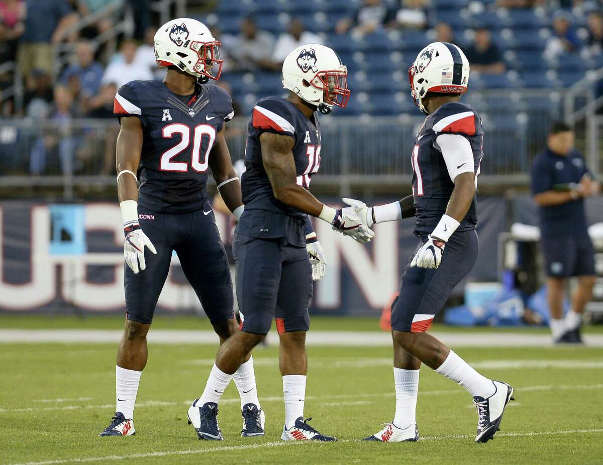 Connecticut's Obi Melifonwu (20), left, Connecticut's Brice McAllister (16), center, and Connecticut's Jamar Summers (21), right, during the first half of an NCAA college football game at Pratt & Whitney Stadium at Rentschler Field against Maine, Thursday, Sept. 1, 2016, in East Hartford, Conn. (AP Photo/Jessica Hill)