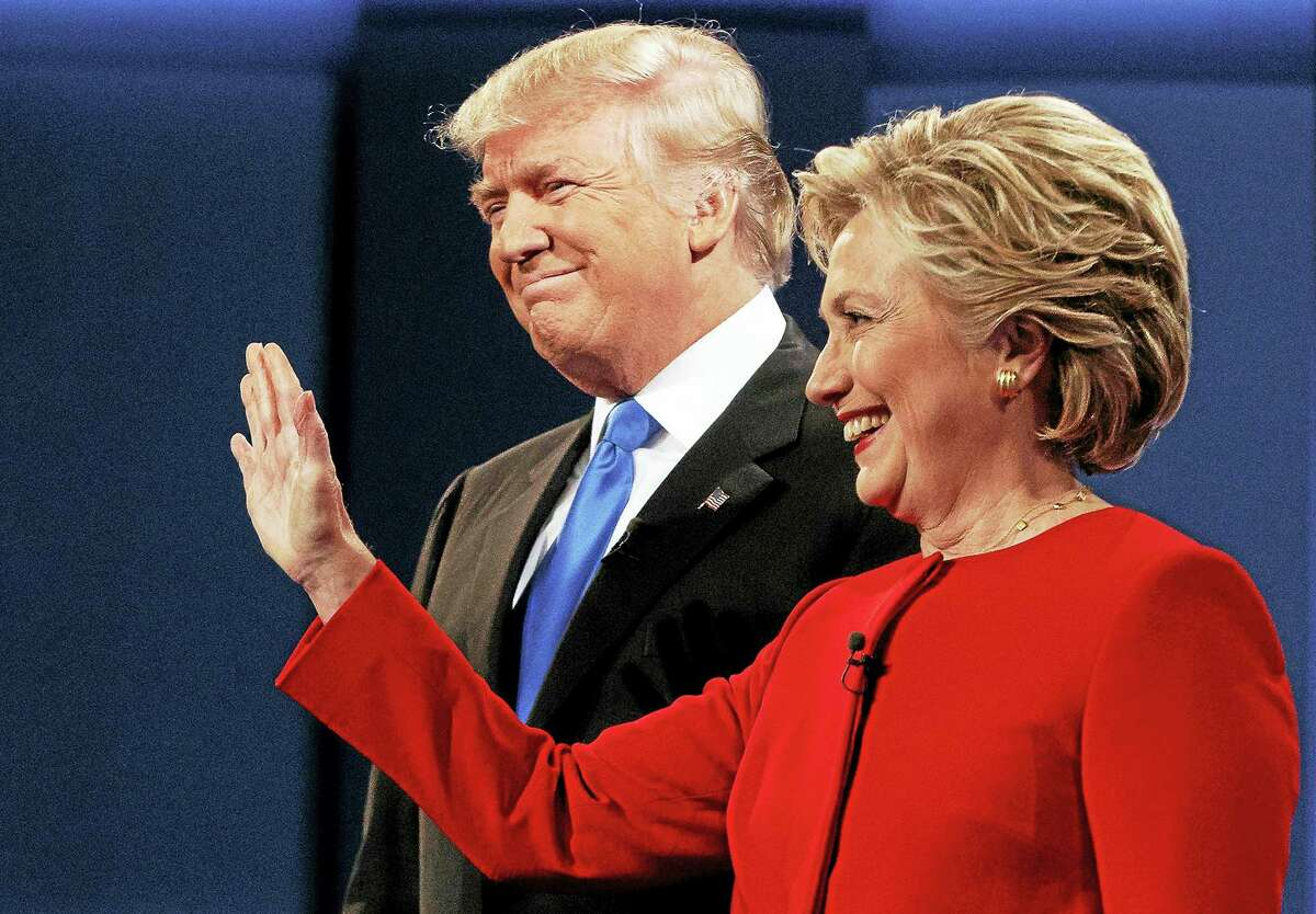 Republican presidential candidate Donald Trump, left, stands with Democratic presidential candidate Hillary Clinton at the first presidential debate at Hofstra University in Hempstead, N.Y. last month.