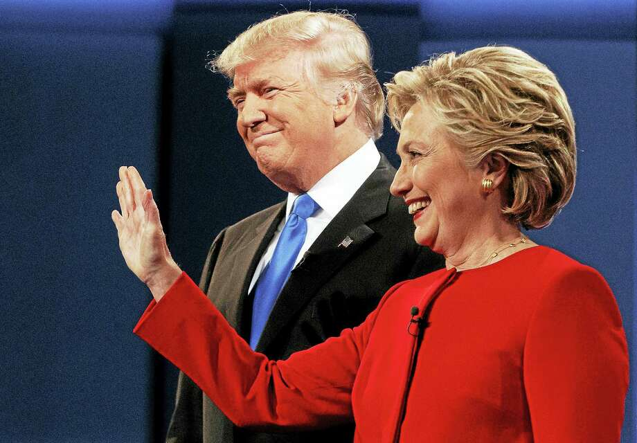 Republican presidential candidate Donald Trump, left, stands with Democratic presidential candidate Hillary Clinton at the first presidential debate at Hofstra University in Hempstead, N.Y. last month. Photo: Evan Vucci — AP Photo / Copyright 2016 The Associated Press. All rights reserved.