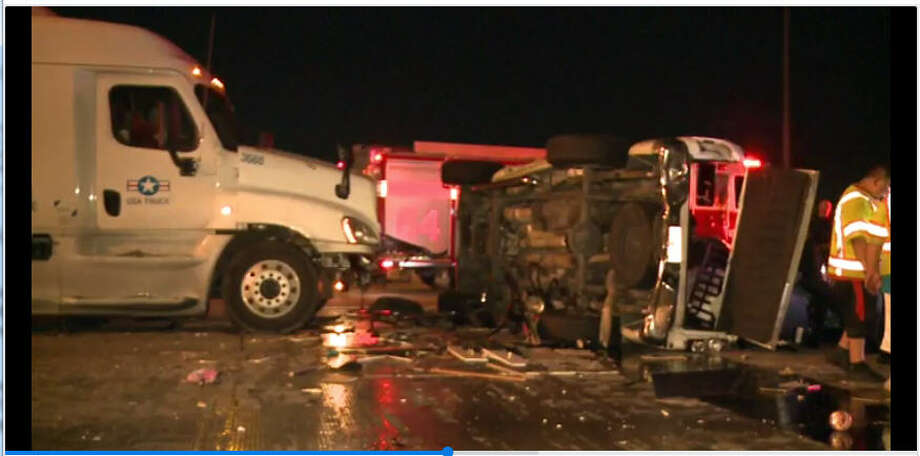 An 18-wheeler apparently struck a pick-up truck towing a trailer on Saturday morning, causing the pick-up to flip on its side on U.S. 59 Freeway, according to authorities.  Photo: Metro Video