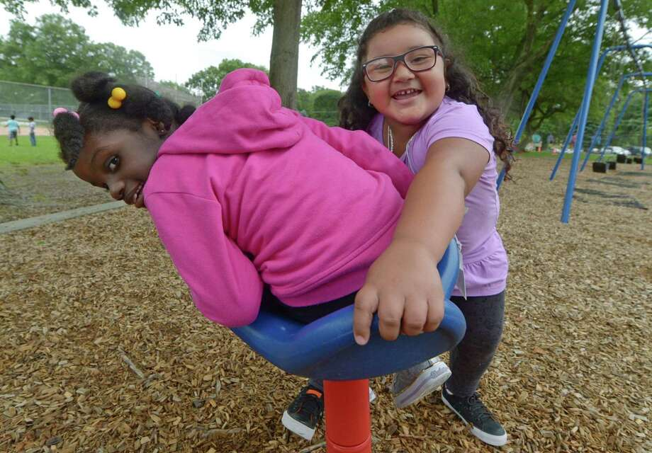 Students from the Norwalk Public Schools Extended School Year (ESY) and Summer Academy programs including Loudeline Aime, 7, and Sophia Freire, 5, play together during integrated recreational time at Fox Run Elementary School in Norwalk. ESY composes the special education and related services after the academic calendar ends each year in June. Photo: Erik Trautmann / Hearst Connecticut Media / Norwalk Hour