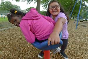 Students from the Norwalk Public Schools Extended School Year (ESY) and Summer Academy programs including Loudeline Aime, 7, and Sophia Freire, 5, play together during integrated recreational time at Fox Run Elementary School in Norwalk. ESY composes the special education and related services after the academic calendar ends each year in June.