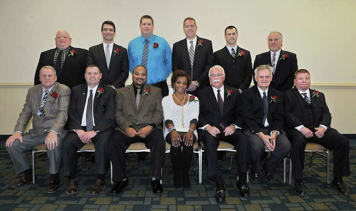 """The newest members of the Middletown Sports Hall of Fame were inducted Thursday evening at Crowne Plaza in Cromwell. Front row: Robert Peterson, Matt Larson, Dario Highsmith, Sr., Frederica Jones Dozier, Joe McCabe, Ed Mann, Todd Isaacson accepting the award for his father, Ted """"Ike"""" Isaacson Jr. (deceased) Back row: Chuck Gill, Paul Laudano, Neal Skene, Kyle Skene, Federico Lago accepting the award for his sister Karina Lago and Carmine Schiro."""