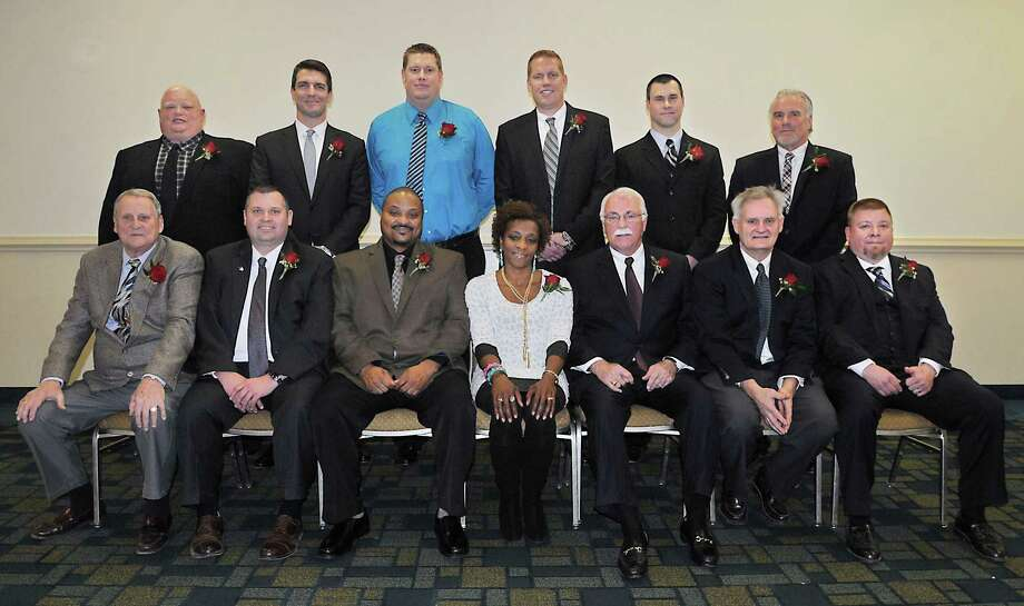 """The newest members of the Middletown Sports Hall of Fame were inducted Thursday evening at Crowne Plaza in Cromwell. Front row: Robert Peterson, Matt Larson, Dario Highsmith, Sr., Frederica Jones Dozier, Joe McCabe, Ed Mann, Todd Isaacson accepting the award for his father, Ted """"Ike"""" Isaacson Jr. (deceased) Back row: Chuck Gill, Paul Laudano, Neal Skene, Kyle Skene, Federico Lago accepting the award for his sister Karina Lago and Carmine Schiro. Photo: Catherine Avalone — The Middletown Press  / TheMiddletownPress"""
