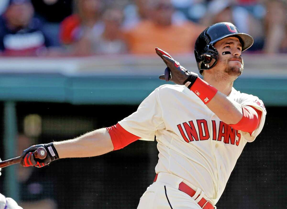 The Indians' Lonnie Chisenhall watches his two-run home run off Colorado Rockies starter Franklin Morales in the sixth inning of Saturday's game in Cleveland.