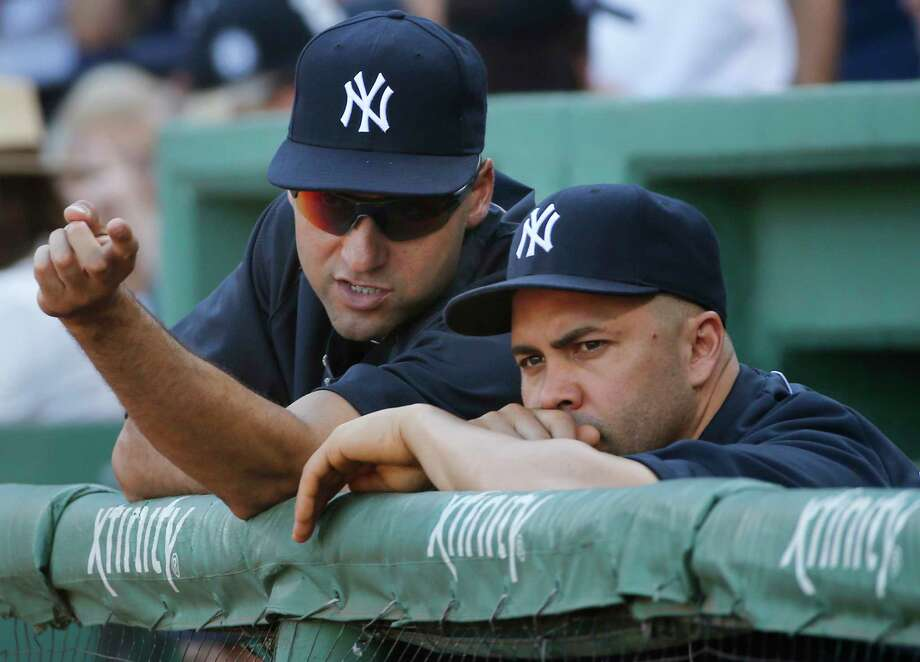 New York Yankees outfielder Carlos Beltran, right, underwent elbow surgery on Tuesday. Photo: Elise Amendola — The Associated Press  / AP