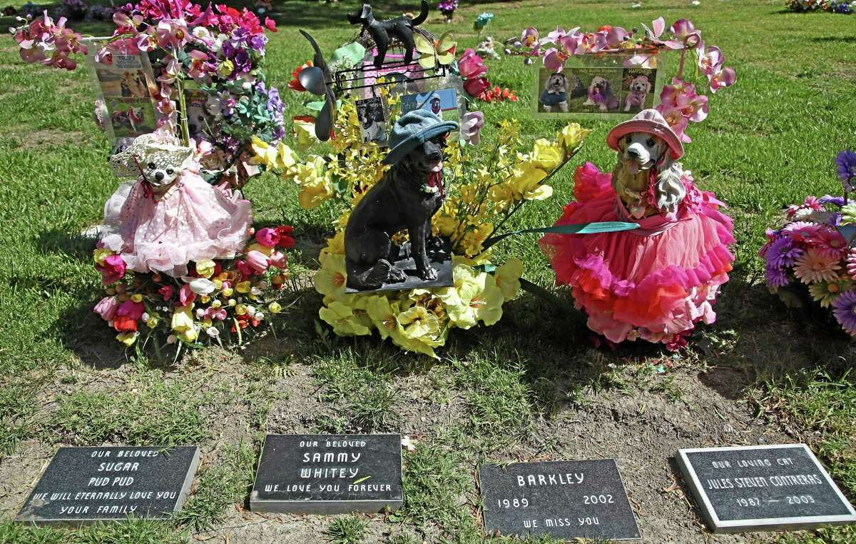 Beloved family pets memorialized with statues at the Los Angeles Pet Cemetery in Calabasas, California.