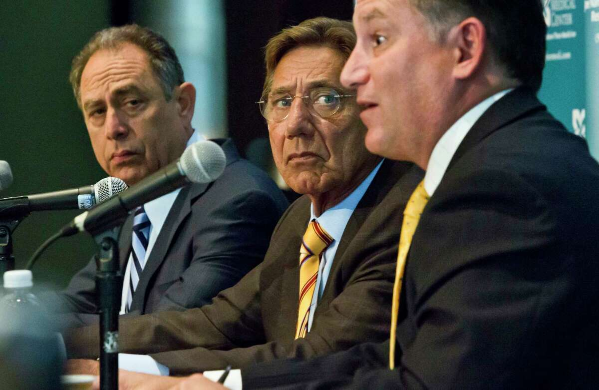 Dr. Barry Miskin, left, and Dr. Lee Fox, right, co-directors of the Joe Namath Medical Research Center, and legendary New York Jets quarterback Joe Namath, center, hold a press conference Tuesday in New York.