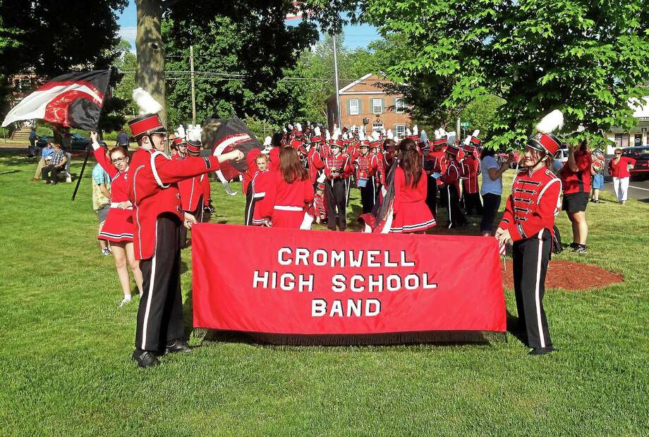 Cromwell's Memorial Day parade Saturday recalled the true meaning of Decoration Day, which hearkens back to the Civil War. The high school band performed along the route as part of the festivities. Photo: Jeff Mill — The Middletown Press
