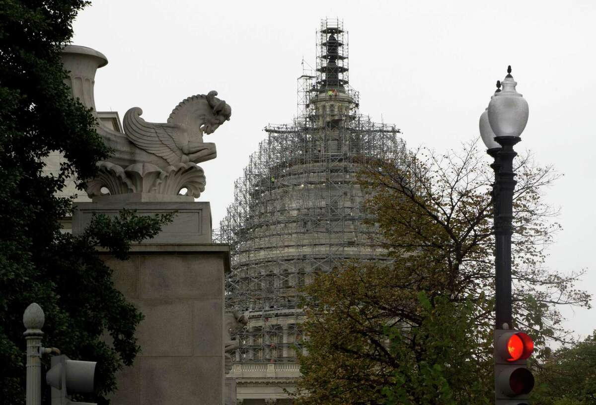 The Capitol Dome, covered with scaffolding is seen on Capitol Hill in Washington, Wednesday, Sept. 30, 2015. On Wednesday, the Senate easily approved a stopgap spending bill to avert government shutdown; House to follow.
