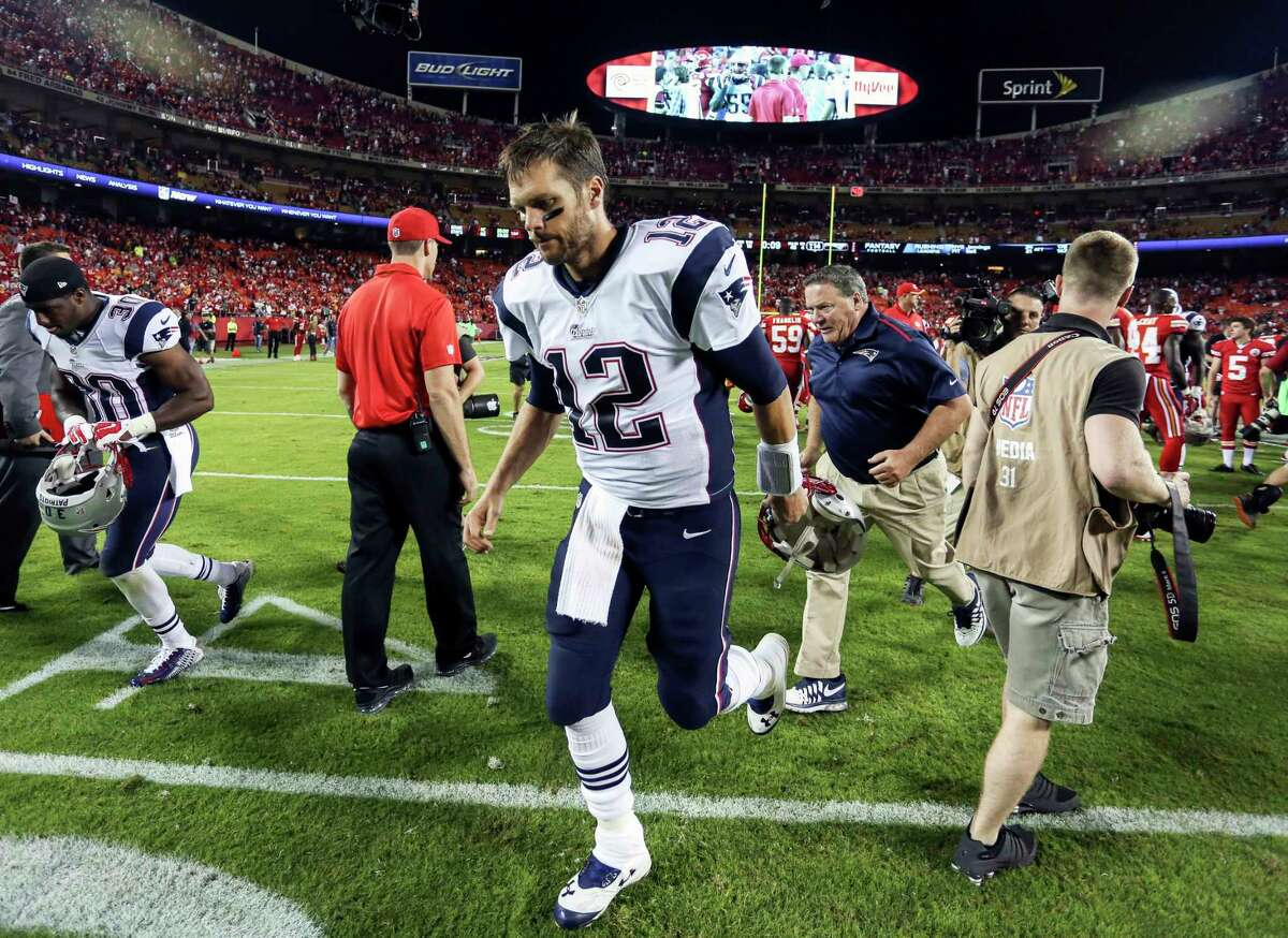 New England Patriots quarterback Tom Brady jogs off the field following a 41-14 loss to the Chiefs on Monday in Kansas City, Mo.