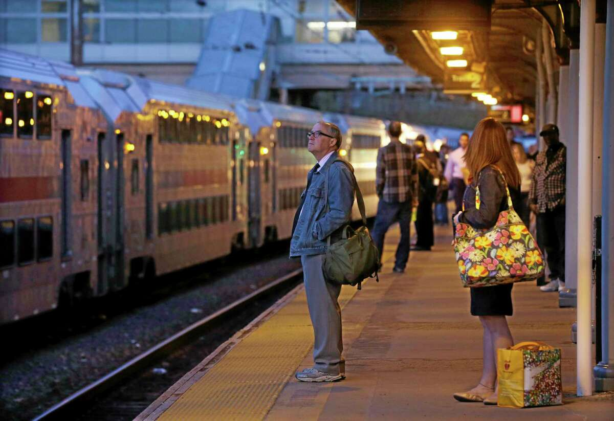 In this April 14, 2014 file photo, commuters wait for an New Jersey Transit train to New York, in Trenton, N.J. Americans took a record 10.7 billion trips on mass transit last year, up 37 percent since 1995, far outpacing population growth. (AP Photo/Mel Evans, File)