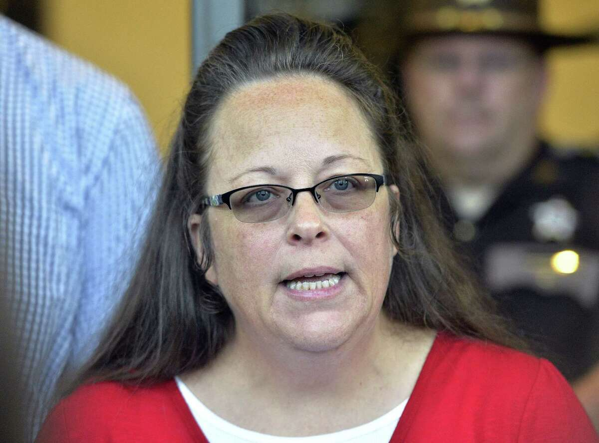 In this Sept. 14, 2015, file photo, Rowan County Clerk Kim Davis makes a statement to the media at the front door of the Rowan County Judicial Center in Morehead, Ky. Davis, who refused to issue marriage licenses to same-sex couples, says she met briefly with the pope during his historic visit to the United States. Vatican officials did not respond to an email asking for comment early Wednesday, Sept. 30.