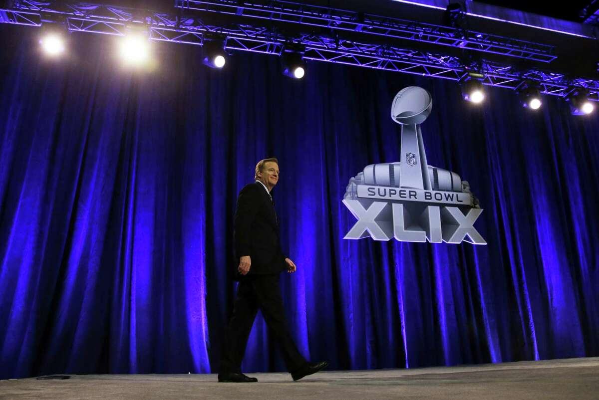 NFL commissioner Roger Goodell makes his way to the podium for a news conference for Super Bowl XLIX Friday in Phoenix.