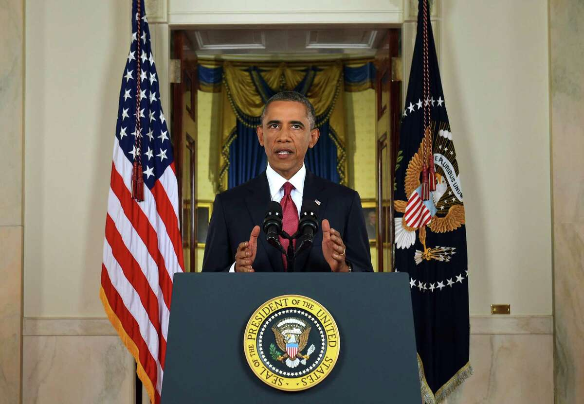In this AP file photo, President Barack Obama addresses the nation from the Cross Hall in the White House in Washington, Wednesday, Sept. 10, 2014. In a major reversal, Obama ordered the United States into a broad military campaign to ìdegrade and ultimately destroyî militants in two volatile Middle East nations, authorizing airstrikes inside Syria for the first time, as well as an expansion of strikes in Iraq.