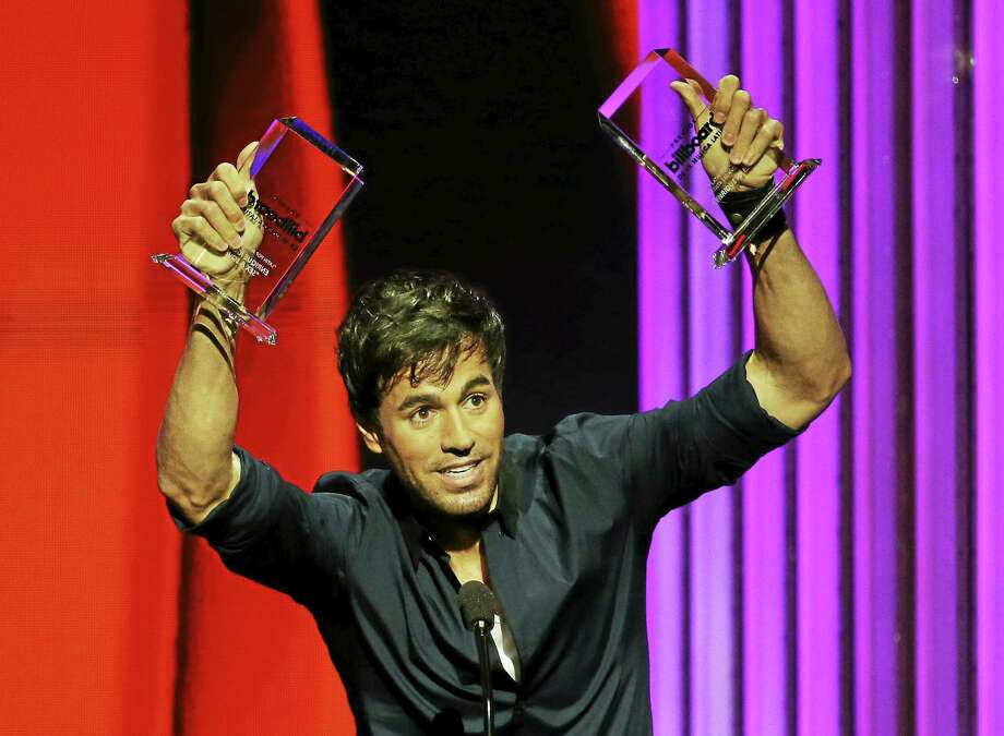 Singer Enrique Iglesias raises the Latin Pop Album of the Year and the Latin Pop Songs Artist of the Year, Solo awards during the Latin Billboard Awards on April 30, 2015 in Coral Gables, Fla. Photo: AP Photo/Lynne Sladky  / AP