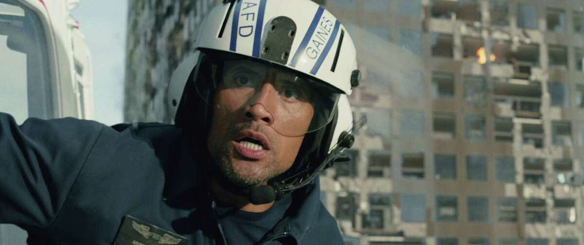 """This photo provided by Warner Bros. Pictures shows Dwayne Johnson as Ray in a scene from the action thriller """"San Andreas."""""""