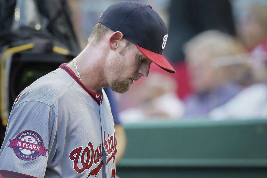 Washington Nationals starting pitcher Stephen Strasburg left Friday's game against the Reds in the second inning with an injury. Photo: The Associated Press  / AP