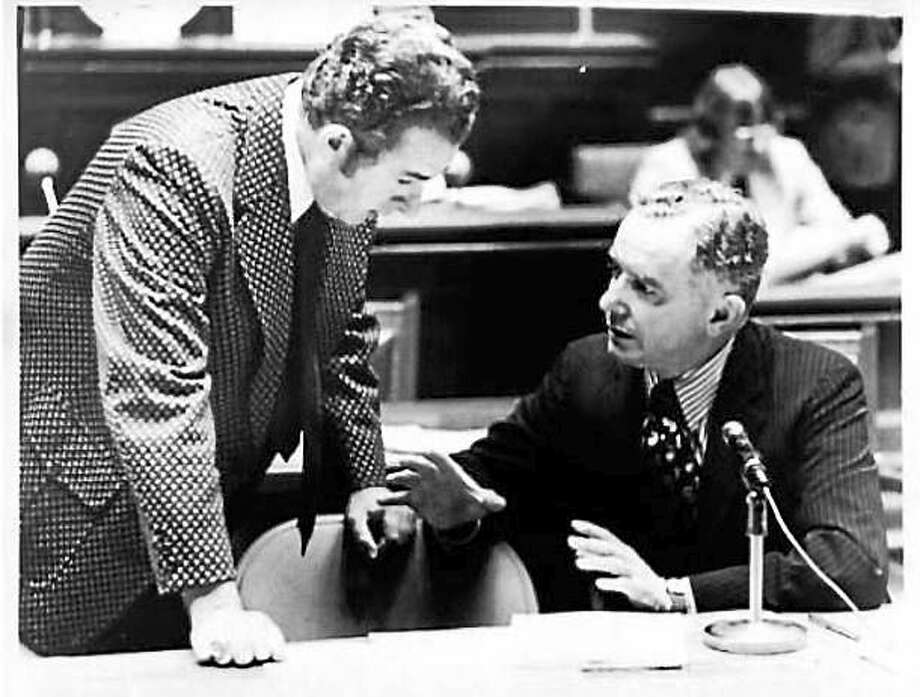 Then-state Rep. and future Gov. William A. O'Neill and state Sen. David M. Barry of Hartford are shown in this archive photo from the 1970s. O'Neill was the first to suggest a hometown heroes program for East Hampton, where he lived. Photo: Courtesy Cthistory.org